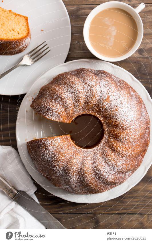 Sponge cake with coffee with milk Yoghurt Dessert Breakfast Coffee Tea Plate Fork Table Wood Fresh Juicy Brown Tradition bundt bundt cake Baking food Home-made