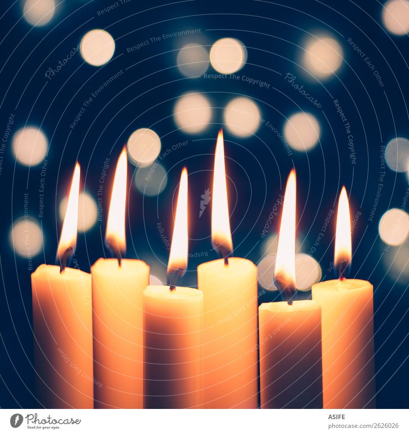 Christmas candles and lights bokeh Feasts & Celebrations Christmas & Advent Group Warmth Candle Glittering Dark Thin Large Bright Long Blue Yellow White Flame