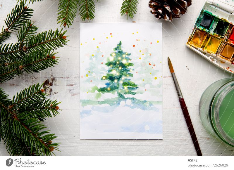 Painting a watercolour Christmas card Design Leisure and hobbies Handcrafts Snow Decoration Table Craft (trade) Tree Paper Wood White Creativity Tradition fir