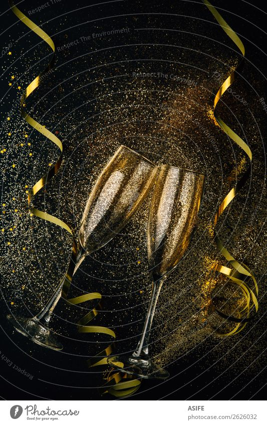 New year with champagne party concept Beverage Alcoholic drinks Luxury Joy Happy Feasts & Celebrations Christmas & Advent New Year's Eve Couple Dark Bright Gold