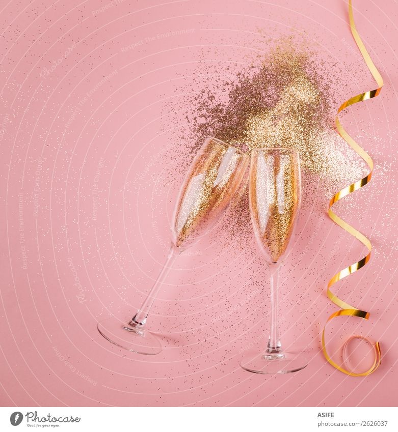 New year party in pink Beverage Alcoholic drinks Luxury Joy Happy Feasts & Celebrations Christmas & Advent New Year's Eve Couple Bright Gold Pink champagne