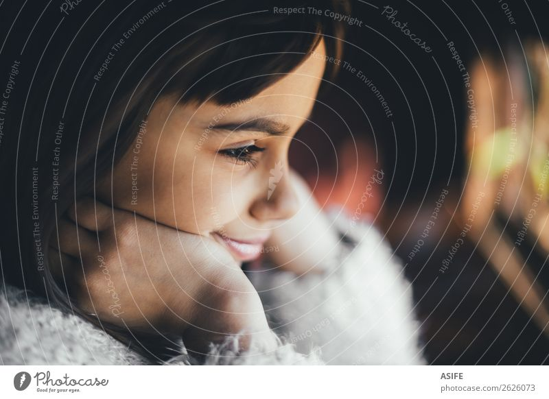 Dreamy and happy little girl looking through the window. Shallow depth of field Joy Happy Beautiful Winter Child Infancy Autumn Warmth Brunette Observe Smiling