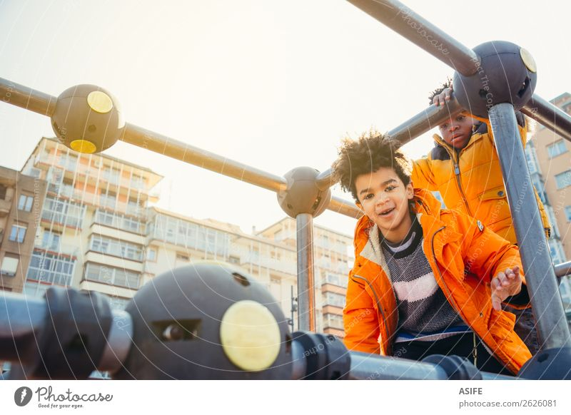 Children having fun in the urban playground Joy Happy Leisure and hobbies Playing Winter Climbing Mountaineering Boy (child) Man Adults Infancy Autumn Park