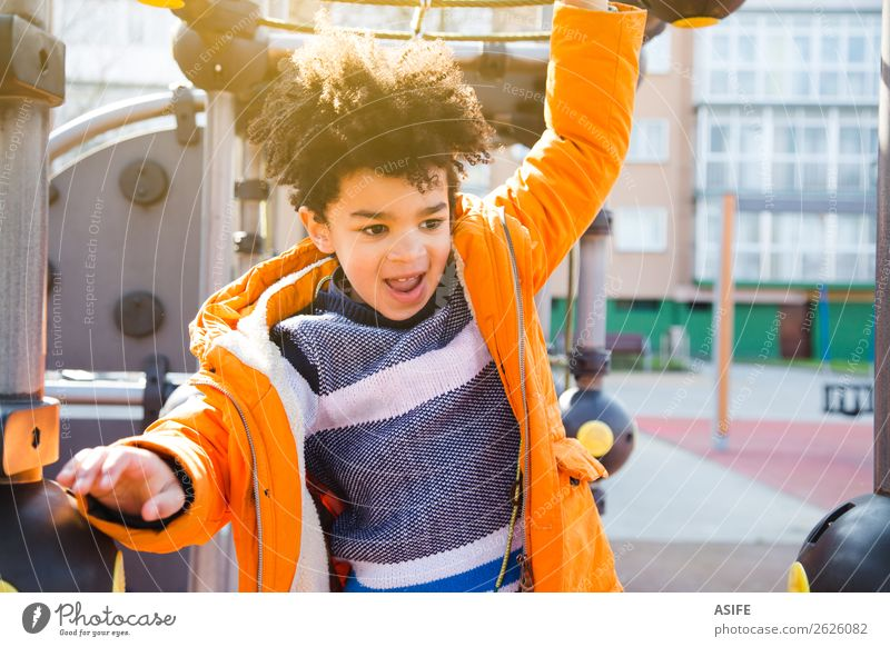 Happy little boy having fun in the playground Joy Leisure and hobbies Playing Winter Climbing Mountaineering Child Boy (child) Man Adults Infancy Autumn Park