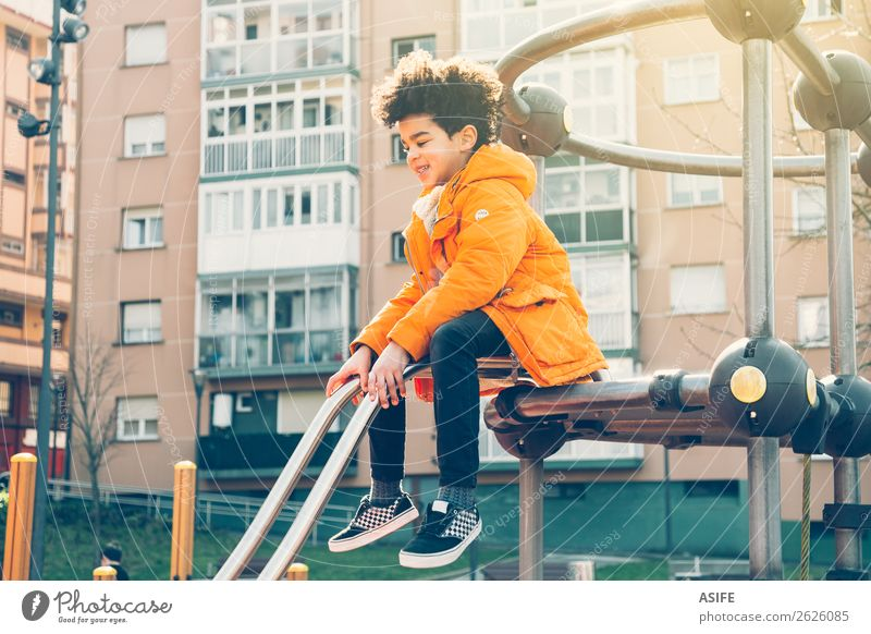 Happy little boy having fun in an urban playground Joy Leisure and hobbies Playing Winter Climbing Mountaineering Child Boy (child) Man Adults Infancy Autumn
