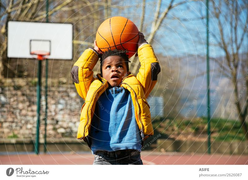 The basket is too high for little boys Joy Happy Relaxation Leisure and hobbies Playing Winter Sports Child School Boy (child) Infancy Autumn Playground Coat