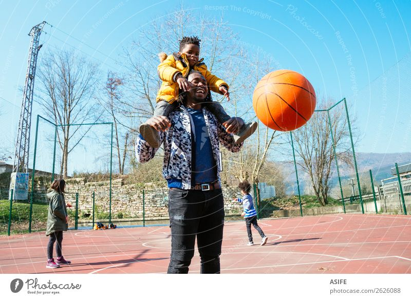 Dad and little son playing basketball Relaxation Joy Winter Black Street Adults Autumn Love Sports Family & Relations Happy Boy (child) Small Playing School