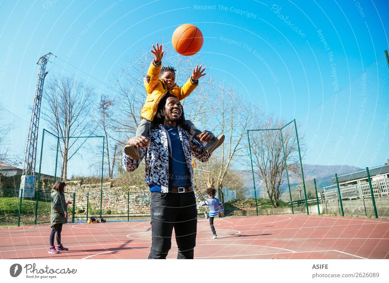 Playing basketball with daddy Relaxation Joy Winter Black Street Adults Autumn Love Sports Family & Relations Happy Boy (child) Small School Together