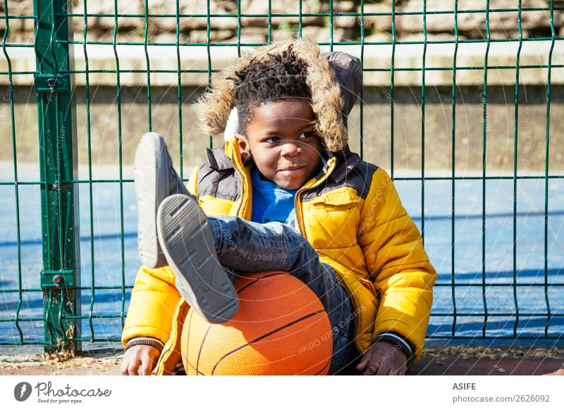 Funny little boy resting after playing basketball Child Relaxation Joy Winter Black Autumn Yellow Sports Happy Boy (child) Small Playing School