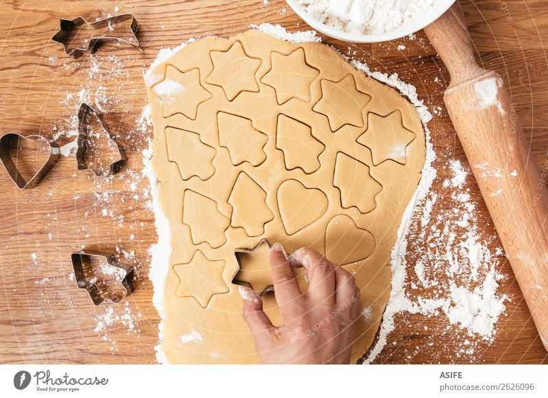 Making Christmas cookies Dough Baked goods Table Christmas & Advent Tree Wood Metal Heart Make Cookie Flour Rolling pin cutters cookie cutter Cut star cooking