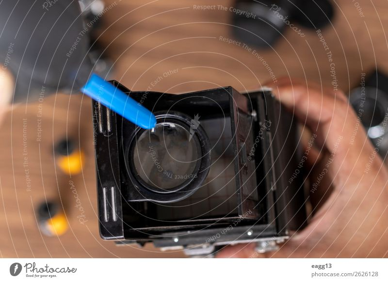 Performing cleaning of vintage photo camera Camera Tool Technology Eyes Old Retro Black Antique Assembly background brush camera cleaning camera disassembly