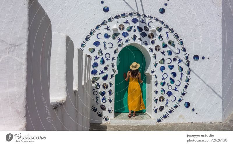 Woman in a decorated arabic door. Lifestyle Style Vacation & Travel Tourism Trip City trip Summer Summer vacation Sun Adults 1 Human being 18 - 30 years
