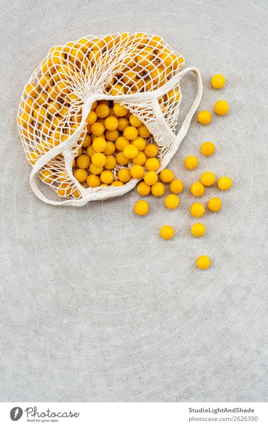Yellow plums in a cotton mesh bag Nature Healthy Eating Summer Colour White Tree Food Lifestyle Autumn Natural Garden Copy Space Orange Gray