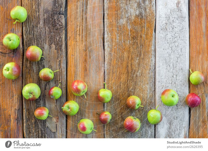 Green and red apples on vintage wooden background Nature Summer Colour Red Tree Food Wood Autumn Natural Garden Copy Space Brown Fruit Nutrition Bright