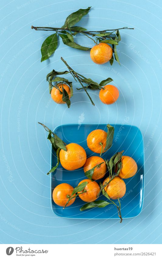 Fresh tangerines in season. Flat lay. Food Dairy Products Fruit Orange Vegetarian diet Diet Juice Healthy Eating Art Natural Blue Green citrus Detox Mature