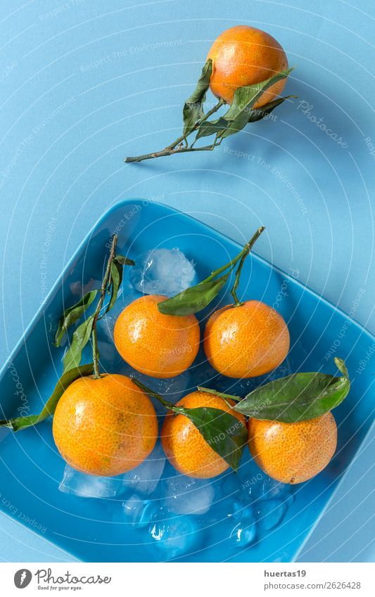 Fresh tangerines in season. Food Fruit Orange Vegetarian diet Diet Juice Healthy Eating Art Natural Blue Green citrus Detox Mature vitamins Organic