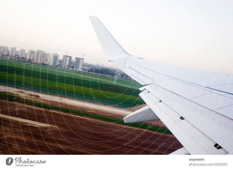 departure Vacation & Travel Far-off places Summer vacation Aviation Cloudless sky Field High-rise Means of transport Airplane Runway Airplane landing