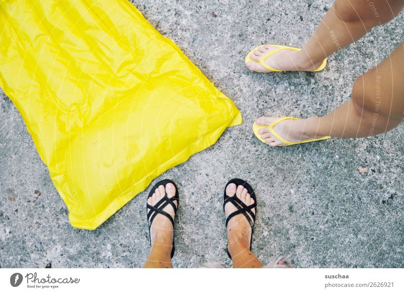 yellow air mattress Air mattress Inflated Summer Vacation & Travel Swimming & Bathing Beach be afloat Yellow Feet 2 people Legs Asphalt Flip-flops Warmth