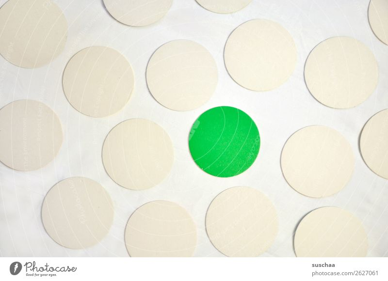 THE GREEN DOT Round Circle Point Colour White Green Symbols and metaphors Associative Center point exception Outsider Marginal group Stick out Protruding