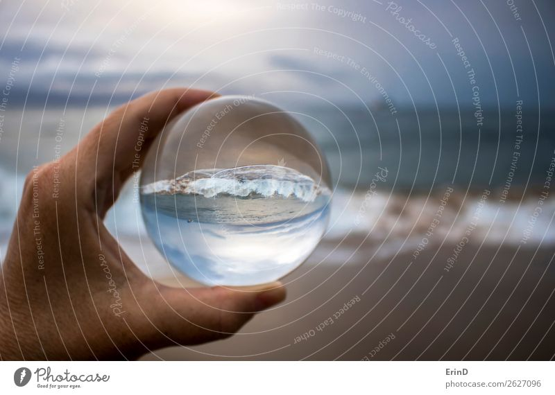 Surf Breaking on Sandy Beach Captured in Glass Ball Design Beautiful Vacation & Travel Ocean Environment Nature Landscape Sky Clouds Weather Storm Coast Sphere