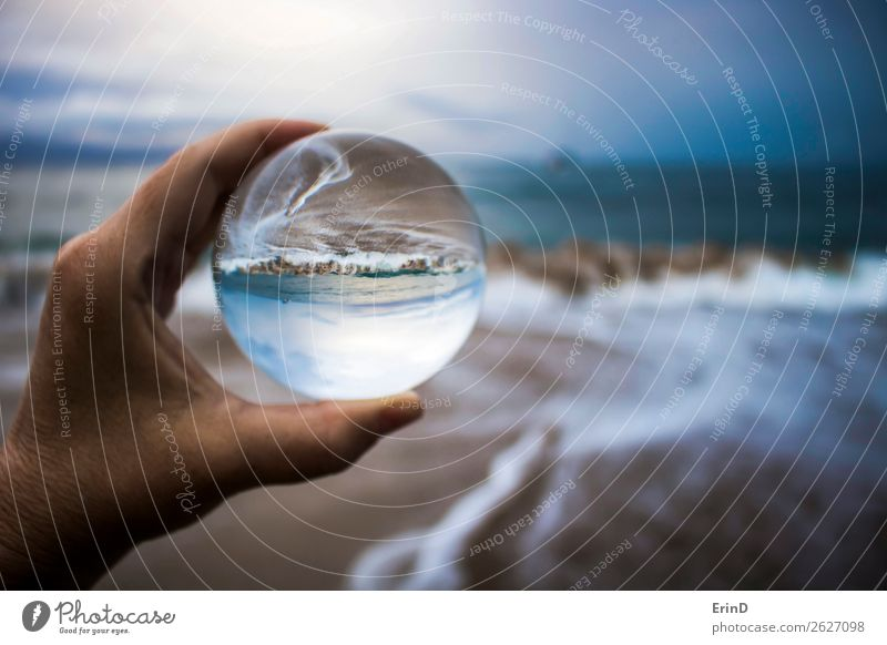 Storm Surf Captured in Glass Ball Reflection Design Beautiful Vacation & Travel Beach Ocean Environment Nature Landscape Sky Clouds Weather Coast Sphere Line