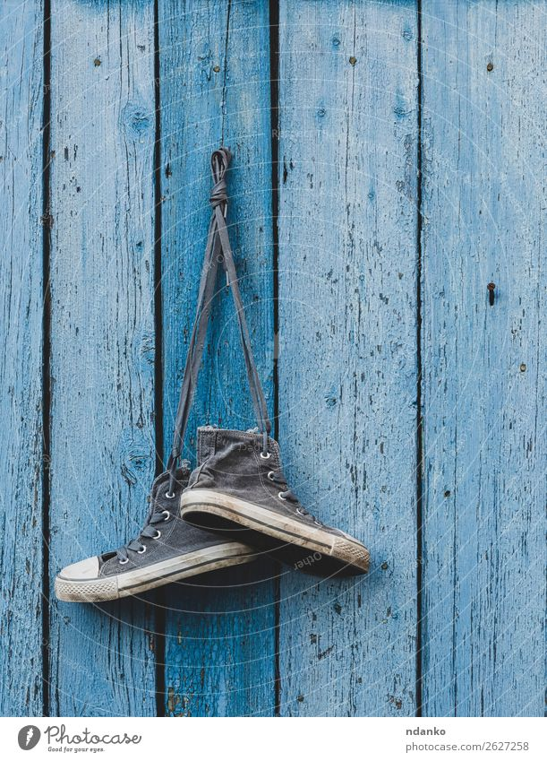 very old textile sneakers hanging on a nail Old Blue Lifestyle Wood Sports Fashion Modern Dirty Footwear Fitness Clothing Idea Fence Hip & trendy Hang Rustic