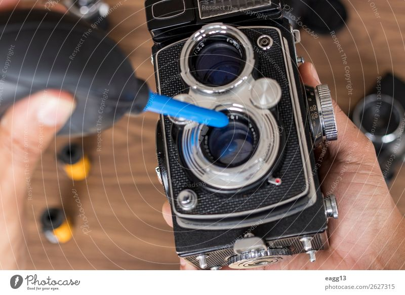 Performing cleaning of vintage photo camera film Leisure and hobbies Camera Tool Technology Eyes Old Retro Black Antique Assembly background brush
