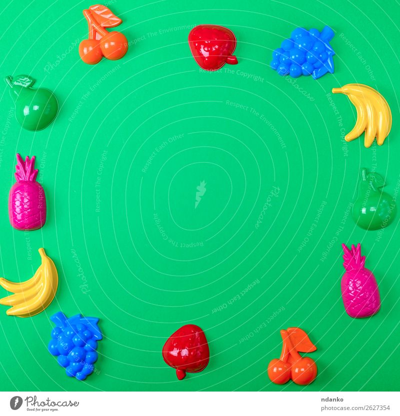 green background with childrens colorful toys Fruit Apple Design Joy Playing Summer Decoration Child Toys Collection Plastic Bright Cute Above Blue Yellow Green