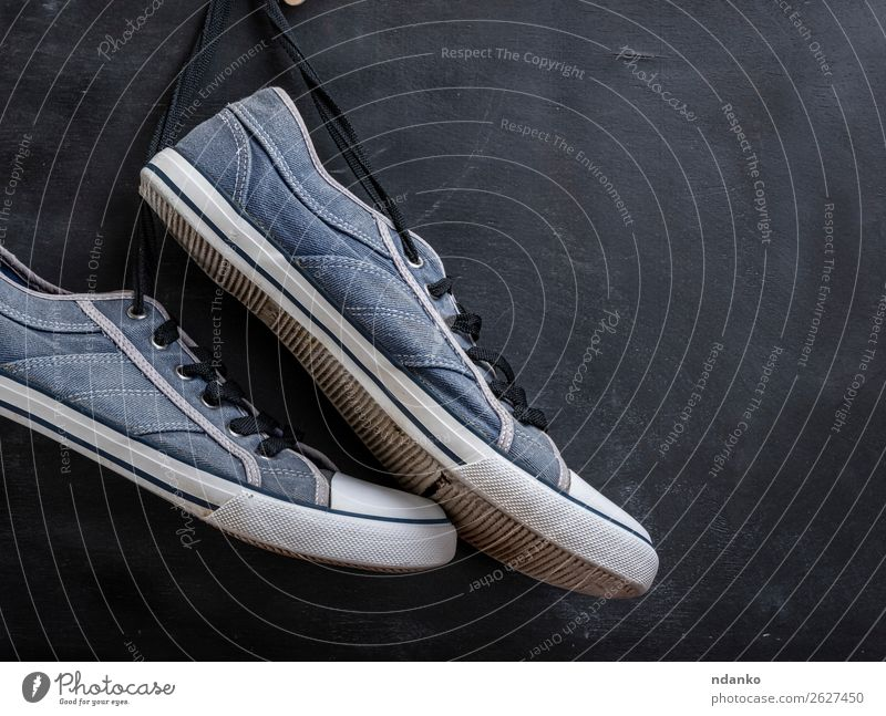 pair of textile blue sneakers hang on a string Old Blue White Black Lifestyle Wood Sports Style Copy Space Fashion Retro Modern Dirty Footwear Fitness Clothing