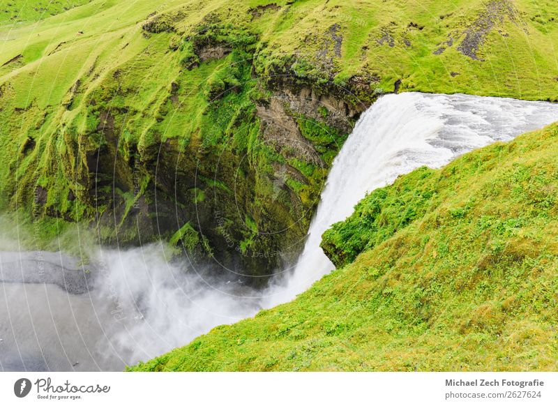 The famous skogafoss waterfall in southern iceland Lifestyle Vacation & Travel Tourism Summer Mountain Human being Man Adults Environment Nature Landscape Sky