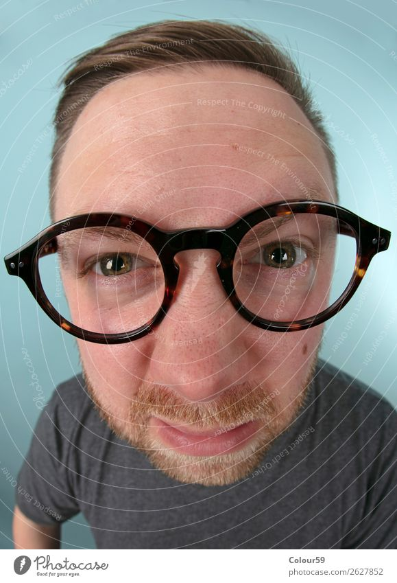 Man with glasses Human being 1 Funny Near Crazy Joy portrait nerd Comic Doofus Eyeglasses Wide angle Grimace eyes Beard warped Colour photo Close-up