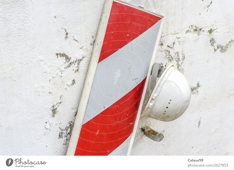 Old construction helmet Wall (barrier) Wall (building) Dirty Safety Protection bark Helmet Hang White frowzy Weathered Warn Flake off Road sign Barque Headwear