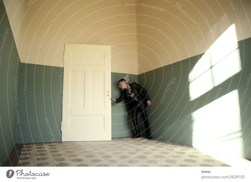 door opener Room Masculine Man Adults 1 Human being Ruin lost places Door Tile Suit Brunette Short-haired Observe To hold on Looking Stand Wait Historic