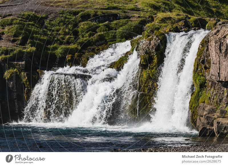 Beautiful waterfall in iceland on a sunny day Vacation & Travel Summer Mountain Nature Landscape Sky Clouds Grass Rock River Waterfall Places Blue Green White