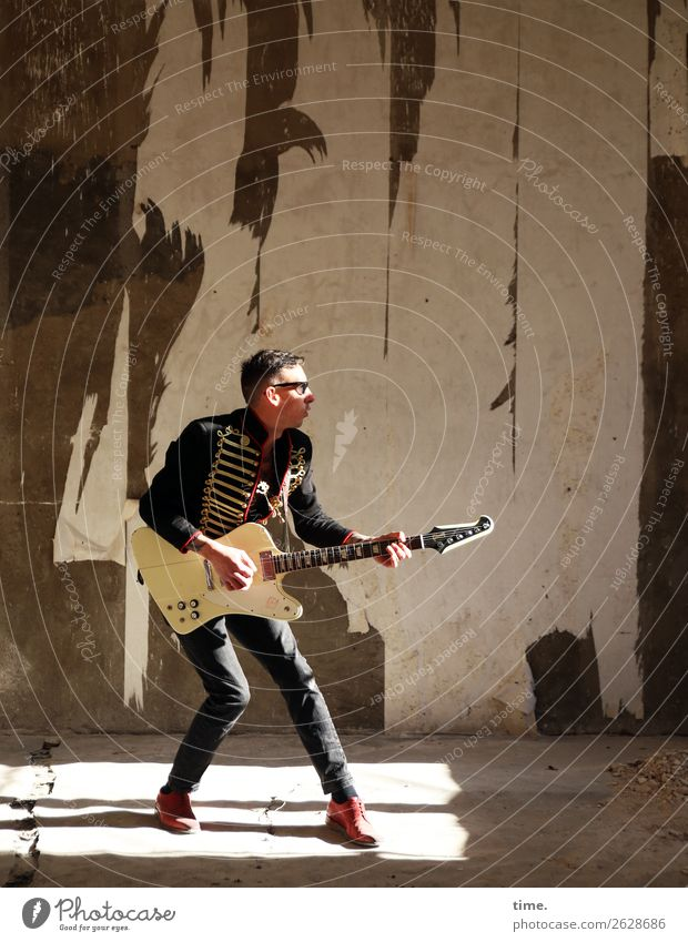 GuitarMan Masculine Adults 1 Human being Artist Music Musician Ruin lost places Wall (barrier) Wall (building) Jacket Sunglasses Short-haired Playing Stand