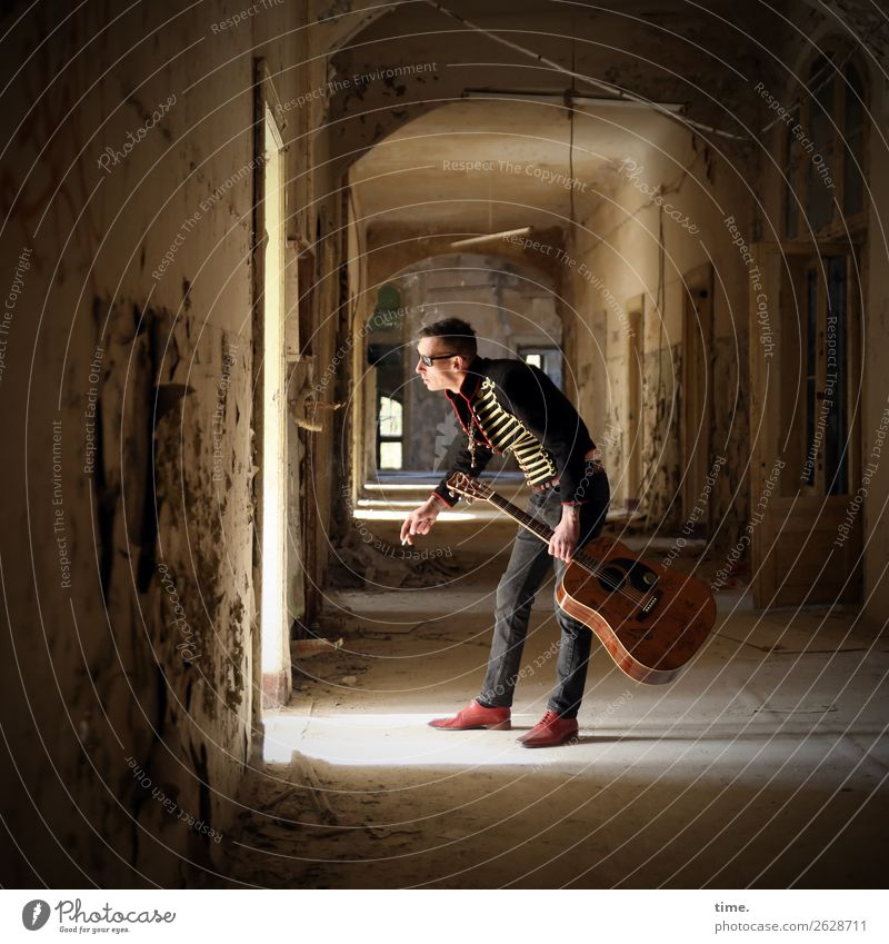 GuitarMan Hallway Masculine Adults 1 Human being Music Musician Ruin Architecture lost places Pants Jacket Sunglasses Brunette Short-haired Observe To hold on