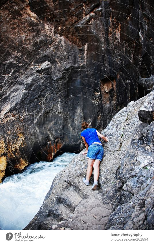 Human being Nature Youth (Young adults) Mountain Gray Rock Adventure Dangerous Threat Elements Young woman Observe River Curiosity Vantage point Discover