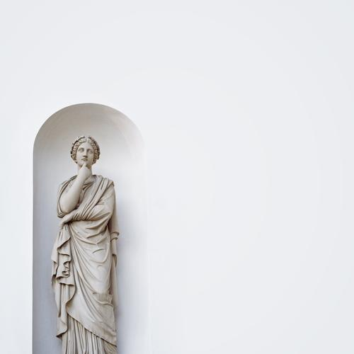 Thoughtful Sculpture Architecture Statue Figure Clothing Dress Cape Wrinkles Folds Wreath Stone Dream Gray White Think Meditative Face Wall (building)