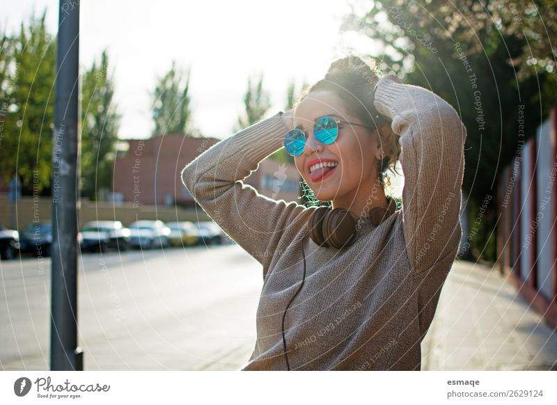 young woman enjoying on the street Human being Youth (Young adults) Young woman Joy Lifestyle Sports Laughter Feasts & Celebrations Garden Park Music Smiling