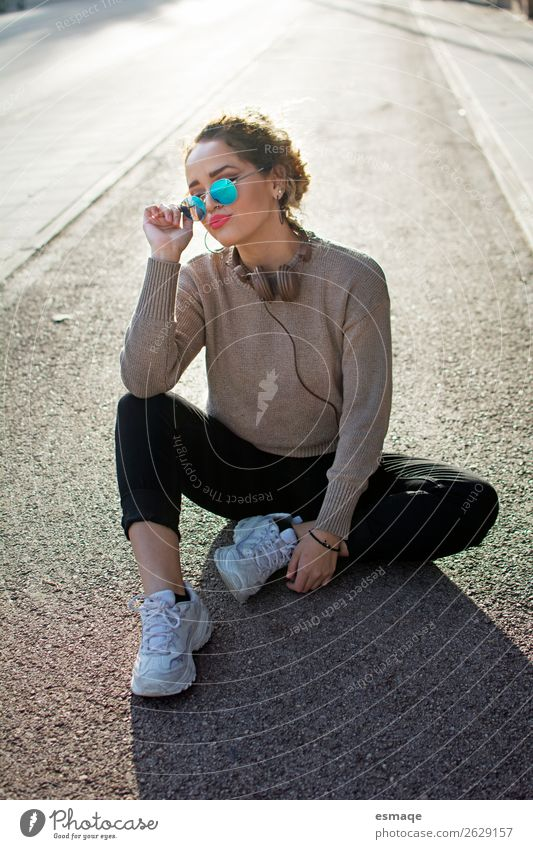 Young woman un street with hesdphones snd sunglasses Lifestyle Shopping Luxury Style Design Joy Music Feminine Youth (Young adults) Woman Adults 1 Human being