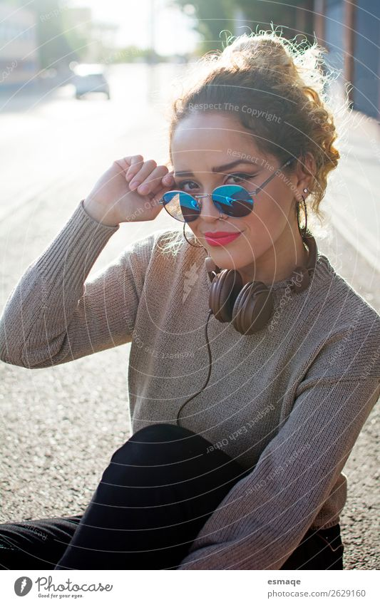 Young woman with Sun glasses and headphones Lifestyle Joy Beautiful Vacation & Travel Adventure Human being Youth (Young adults) Music Listen to music Village