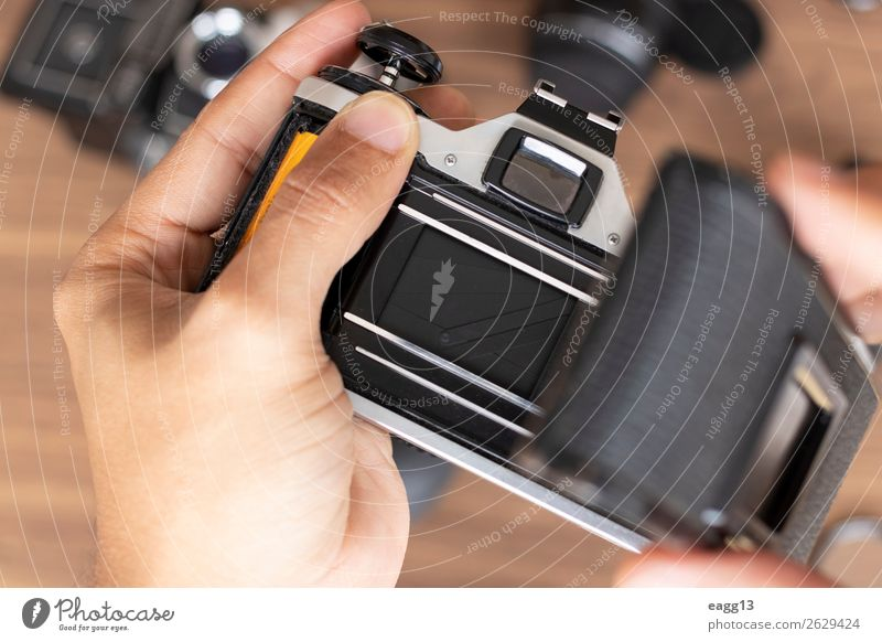 Placing photographic roll in a camera film Entertainment Work and employment Screen Camera Technology Human being Art Media Old Retro Black Creativity 35mm
