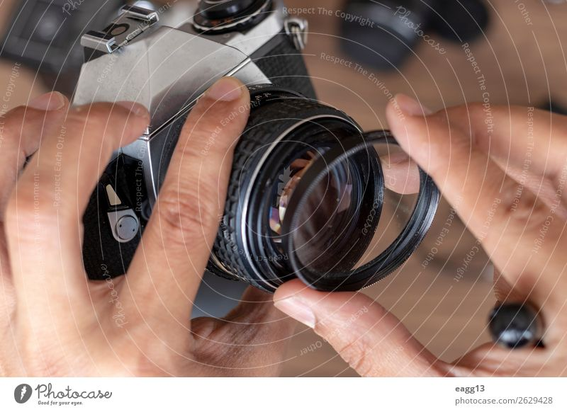 Placing a filter photographic camera film Lifestyle Style Camera Technology Eyes Places Old Modern Retro Black Creativity Flash Aperture background