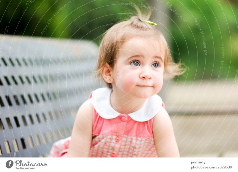 Adorable little girl playing in a urban park Lifestyle Joy Happy Beautiful Leisure and hobbies Playing Summer Child Human being Baby Girl Woman Adults Infancy 1