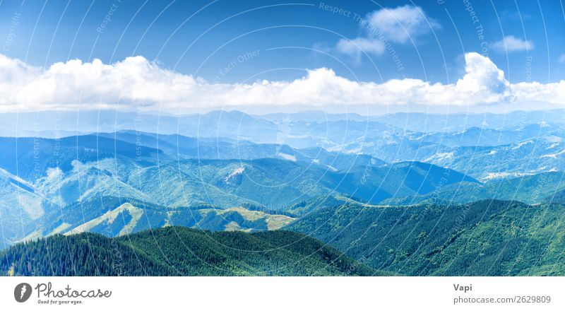 Panorama of blue mountains and hills Sky Vacation & Travel Nature Summer Blue Beautiful Green Landscape White Tree Clouds Forest Far-off places Mountain Yellow