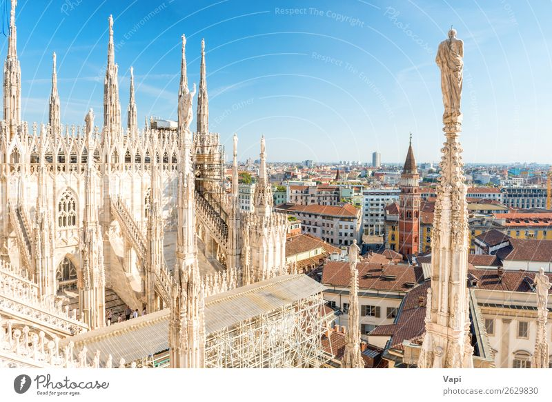 White statue on top of Duomo cathedral Sky Vacation & Travel Old Summer Blue Town Red Clouds Black Architecture Religion and faith Yellow Building Tourism Stone