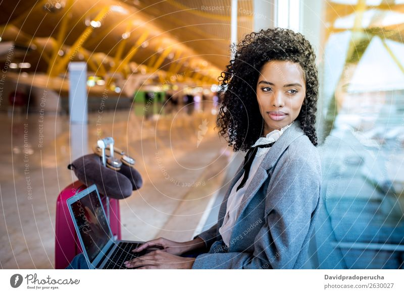 black woman working with laptop at the airport waiting at the window Airport Youth (Young adults) Smiling Wait Black Woman Story Sun Sunrise Window Sunlight