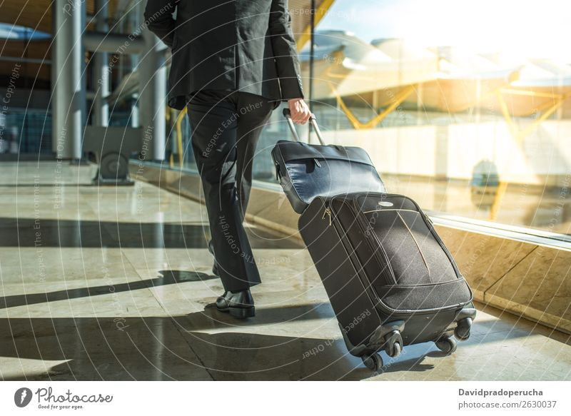 businessman back and legs walking with luggage at the airport Airport Businessman Back Walking Legs Luggage step Window Departure lounge Suit Man