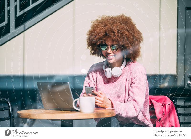 Mixed race woman in a coffee shop with mobile phone Woman Adults Black African-American Lifestyle Mobile Telephone PDA Communication Work and employment Curly