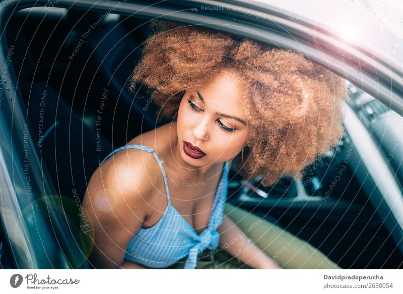 Mixed race woman sitting in a car Woman Smiling Portrait photograph Black Lifestyle Transport Car